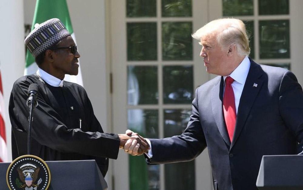 """Foto19 Muhammadu Buhari e Donald Trump Trump """"se esquiva"""" e não pede desculpas por comentários sobre África"""